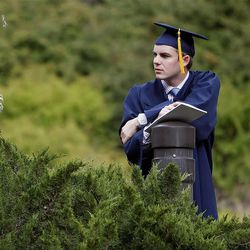 Seth Frischknecht waits for his family after Spring Commencement Exercises at BYU Thursday, April 19, 2012 in the Marriott Center.