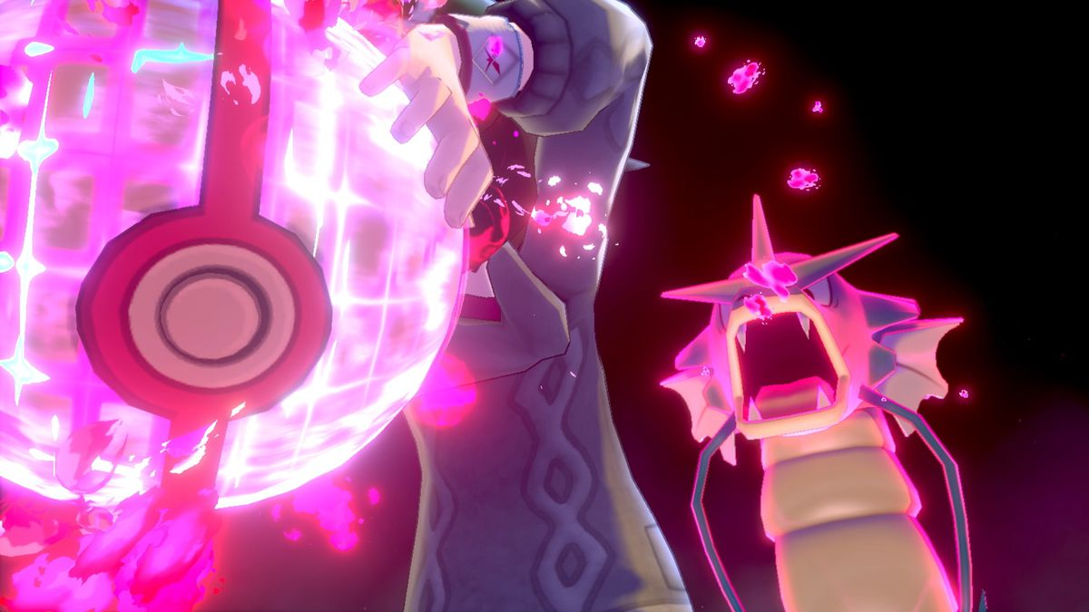 A trainer attempts to capture a dynamax Pokemon.