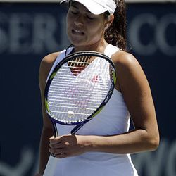 Ana Ivanovic, of Serbia, reacts after missing a shot against Samantha Stosur, of Australia.