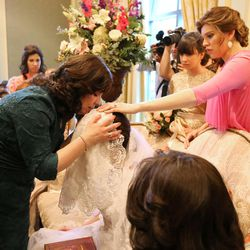 Sharonne Zippel blesses her daughter, Chaya Zippel, during the badeken, or veiling ceremony, before she marries Rabbi Mendy Cohen in a traditional Chabad Lubavitch Jewish ceremony at the Grand America Hotel in Salt Lake City on Monday, Sept. 12, 2016.