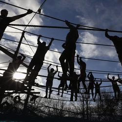 competitors in action during the Tough Guy Challenge on January 27, 2013 in Telford, England.