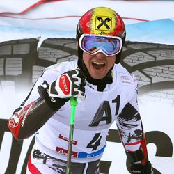Austria's Marcel Hirscher celebreates his third place after completing an alpine ski, men's World Cup giant slalom, in Soelden, Austria, Sunday, Oct. 27, 2013. Ted Ligety maintained his dominance in giant slalom by taking the season-opening World Cup race by a 0.79-second winning margin Sunday, while Bode Miller finished 19th upon his return to the circuit following a 20-month injury layoff. (AP Photo/Giovanni Auletta)