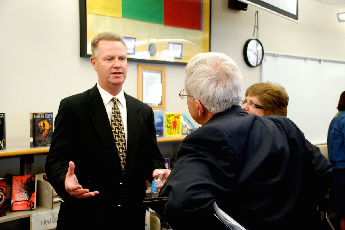 Dan McMinimee, left, meets with members of the Jefferson County community May 15. McMinimee, a Dougco administrator, is the sole finalist to become superintendent of Jeffco Public Schools.