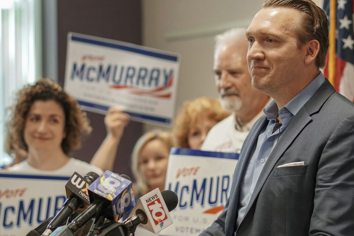 In this Aug. 9, 2018 photo, provided by Nate McMurray for Congress, Nate McMurray, the Democrat who is running in the 27th Congressional District, speaks to supporters in Rochester, N.Y., the day after his opponent, U.S. Rep. Christopher Collins, R-N.Y.,