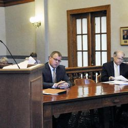 Attorneys representing both sides in the Hardy Billington Et Al V Robin Carnahan case were in a Cole County courtroom Friday, Sept. 7, 2012, in Jefferson City, Mo. At the podium is Kansas City attorney, Clayton Callen, speaking on behalf of the plaintiff, Hardy Billington et al. Seated at table, from left, are: attornies Brent Haden, James Layton and Heidi Doerhoff Vollet.