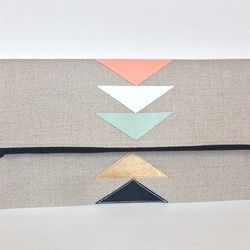 """<a href=""""https://www.etsy.com/shop/thislovesthat"""">This Loves That</a>. Envelope clutches and chunky wood jewelry with a great use of pastel colors and gold touches"""