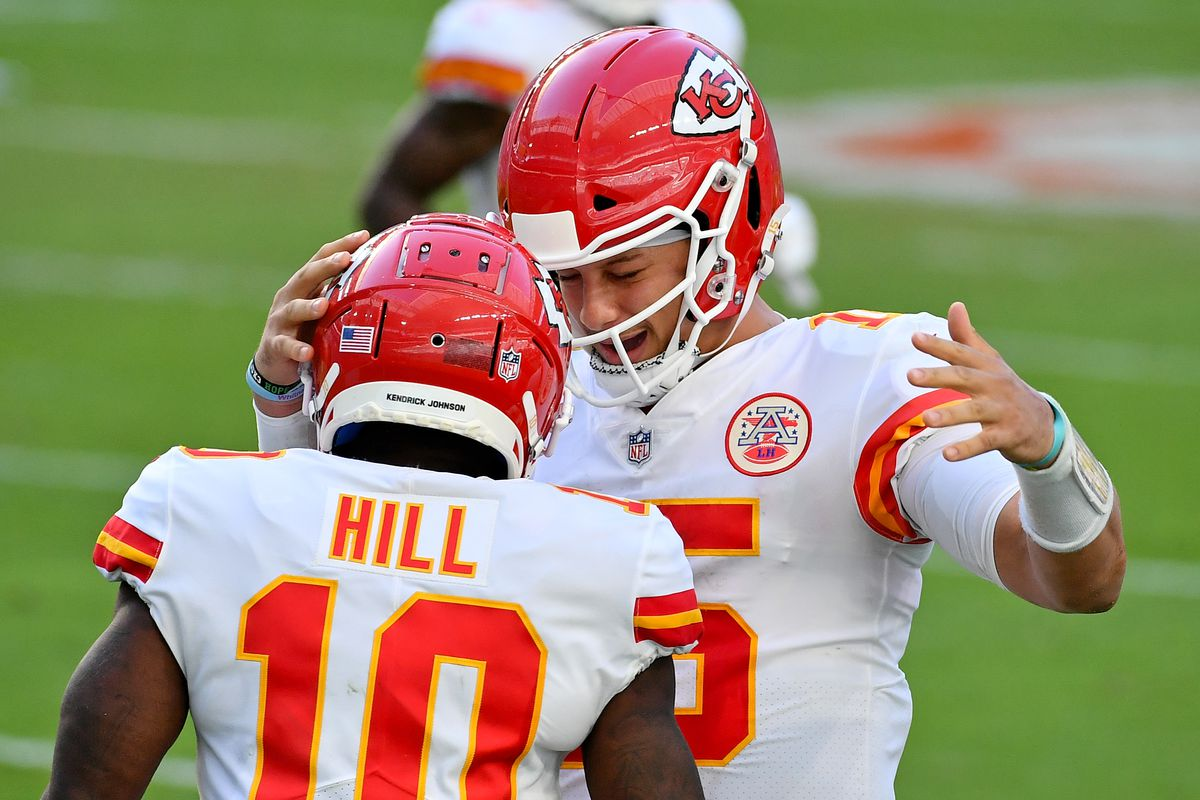 Kansas City Chiefs wide receiver Tyreek Hill (10) celebrates his touchdown against the Miami Dolphins with quarterback Patrick Mahomes (15) during the second half at Hard Rock Stadium. Mandatory Credit: Jasen Vinlove