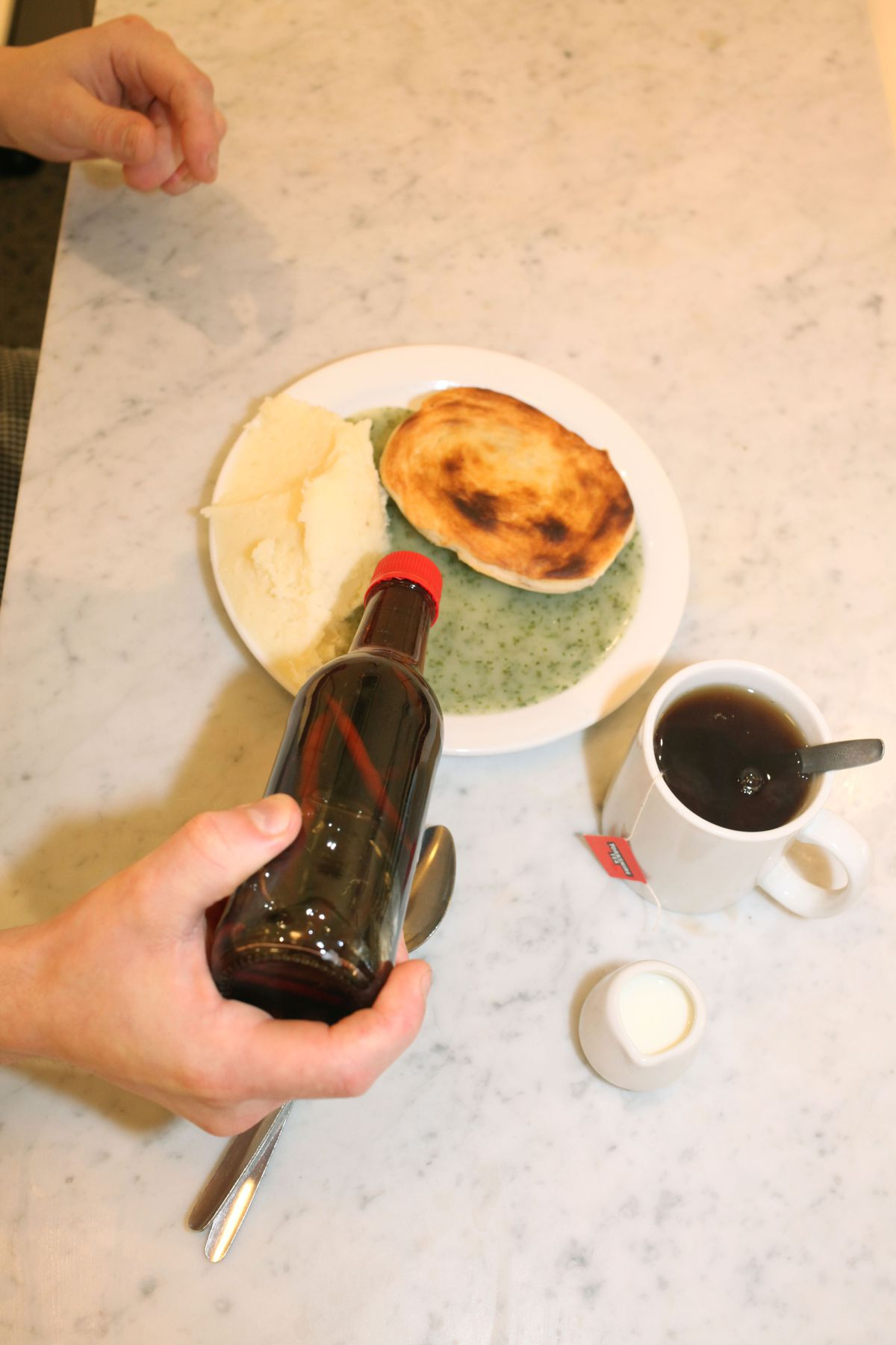 Pie, mash, liquor, chilli vinegar, and a cup of tea at G.Kelly on the Roman Road, in east London