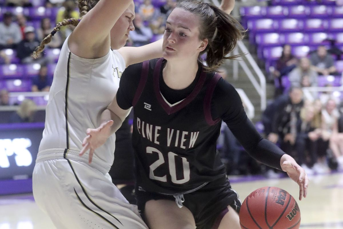 Pine View's Averi Papa moves around Desert Hills' Shailee Bundy during the 4A girls basketball state semifinals at the Dee Events Center in Ogden on Friday, Feb. 28, 2020. Pine View won 53-41.