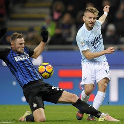 Ciro Immobile of SS Lazio compete for the ball with Milan Skriniar of FC Internazionale during the serie A match between FC Internazionale and SS Lazio at Stadio Giuseppe Meazza on December 30, 2017 in Milan, Italy.