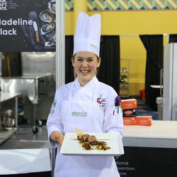 Utah Valley University culinary student Madeline Black displays her award-winning dish of duck roulade during the American Culinary Federation Cook. Craft. Create. national convention on July 8-13 in Orlando, Florida. Black was named the National Student Chef of the Year after making truffle-scented duck roulade finished in duck fat, with Utah honey lacquered duck thigh-riblet.