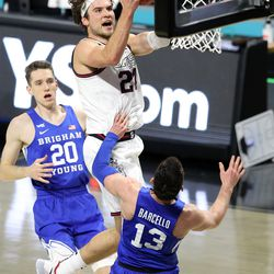 Gonzaga Bulldogs center Oumar Ballo (21) drives at Brigham Young Cougars guard Alex Barcello (13) for a basket and one as BYU and Gonzaga play in the finals of the West Coast Conference tournament at the Orleans Arena in Las Vegas on Tuesday, March 9, 2021. Gonzaga won 88-78.