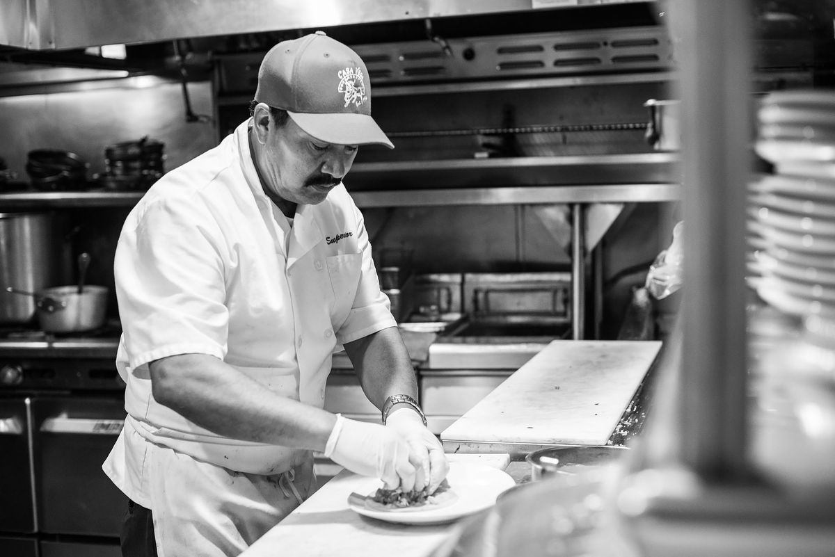 Braulio Arellano plating a dish at Casa Vega