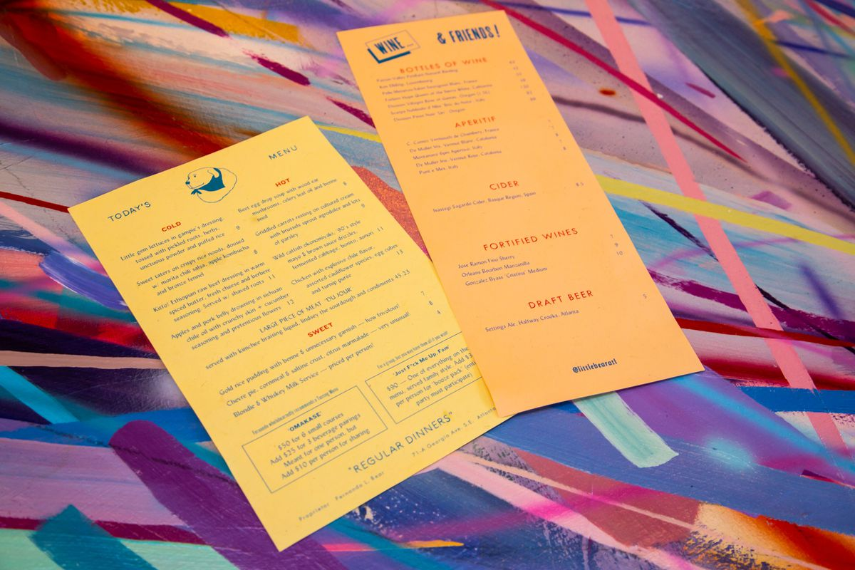 The food and drinks menu on the multi-colored striped bar top at Little Bear in Summerhill Atlanta