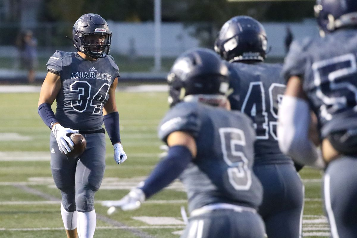 Corner Canyon linebacker Josh Wilson screams after recovering a fumble during football game against Lone Peak at Corner Canyon High School in Draper on Friday, Sept. 27, 2019.