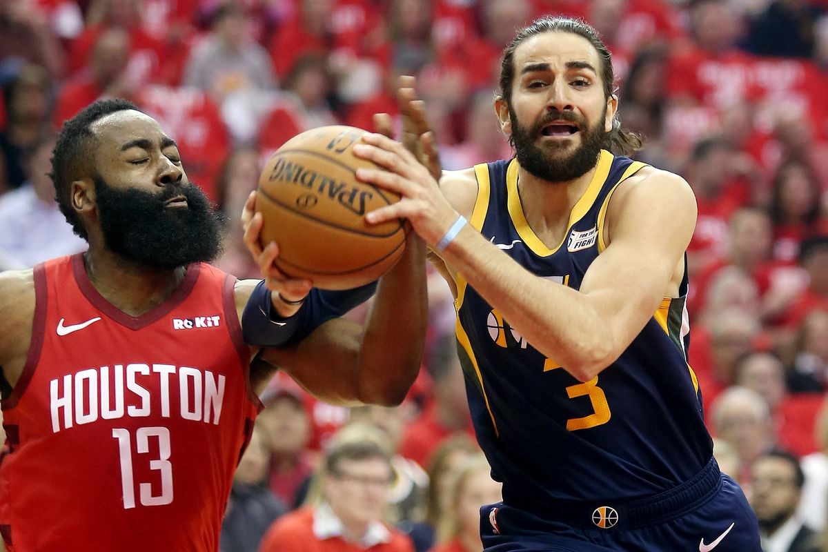 Houston Rockets guard James Harden (13) defends Utah Jazz guard Ricky Rubio (3) as the Utah Jazz and the Houston Rockets play in game 2 of the NBA Western Conference playoffs at the Toyota Center in Houston Texas on Wednesday, April 17, 2019.