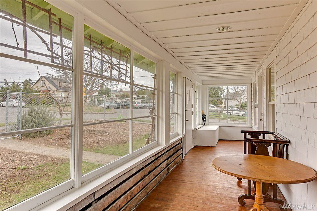 A sunroom with white walls