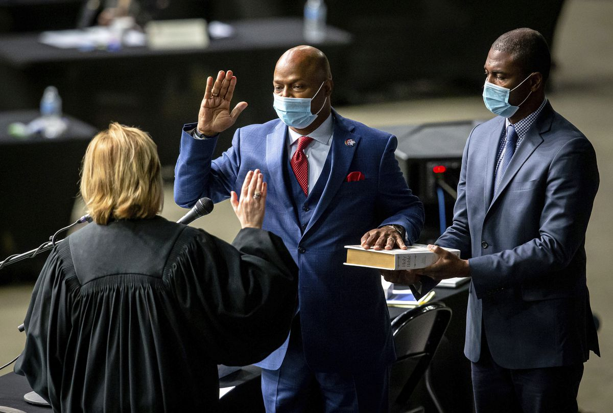 """Newly elected House Speaker Emanuel """"Chris"""" Welch takes the oath of office at the Illinois House of Representatives at the Bank of Springfield Center on Wednesday."""