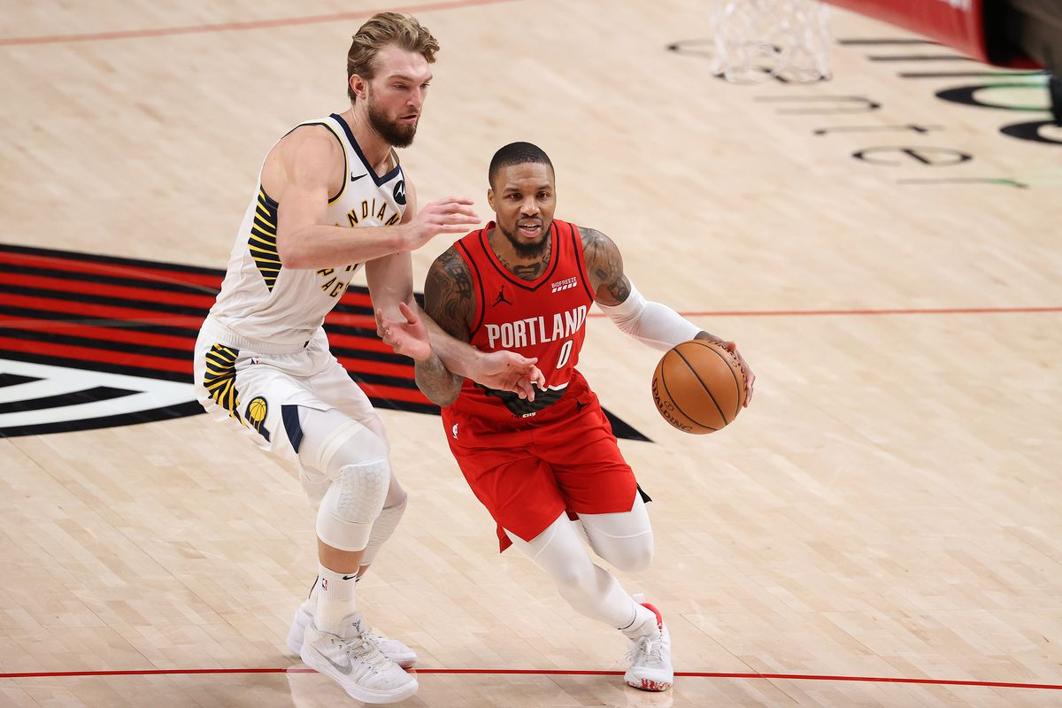 Damian Lillard of the Portland Trail Blazers dribbles against Domantas Sabonis of the Indiana Pacers in the fourth quarter at Moda Center on January 14, 2021 in Portland, Oregon.