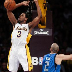 Los Angeles Lakers forward Devin Ebanks dunks over Dallas Mavericks guard Jason Kidd during the first half of an NBA basketball game, Sunday, April 15, 2012, in Los Angeles.