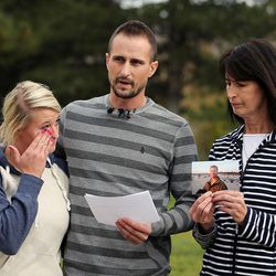 Russell Jacobs' niece Kallie Stolk, left, nephew Brian Stolk and Lyne Miller, a cousin to Jacobs' wife, speak at a press conference Friday, Oct. 30, 2015, in East Millcreek. Miller holds a photo of Jacobs, who died after being shot Oct. 29, 2015.