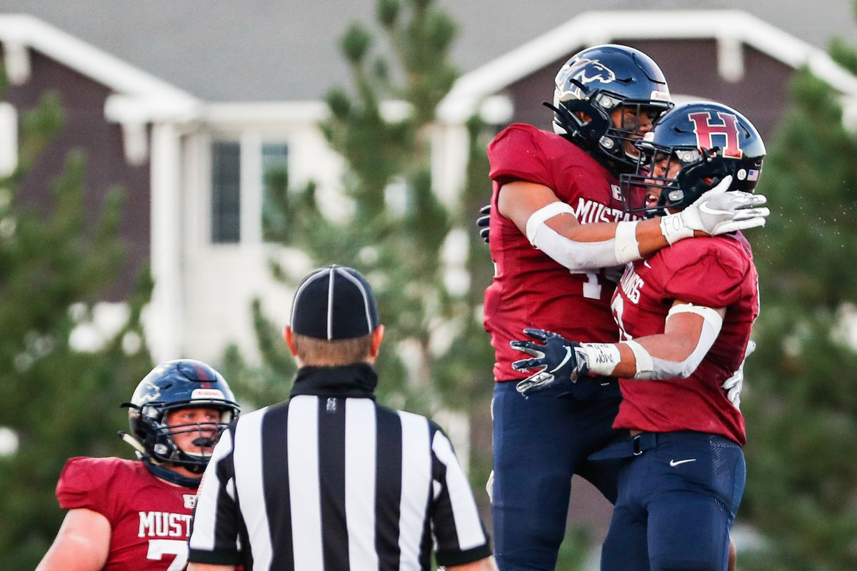 Herriman's Afa Kula (10) celebrates with his teammates after scoring the team's first touchdown during a high school football game at Herriman High School in Herriman on Friday, Sept. 4, 2020.