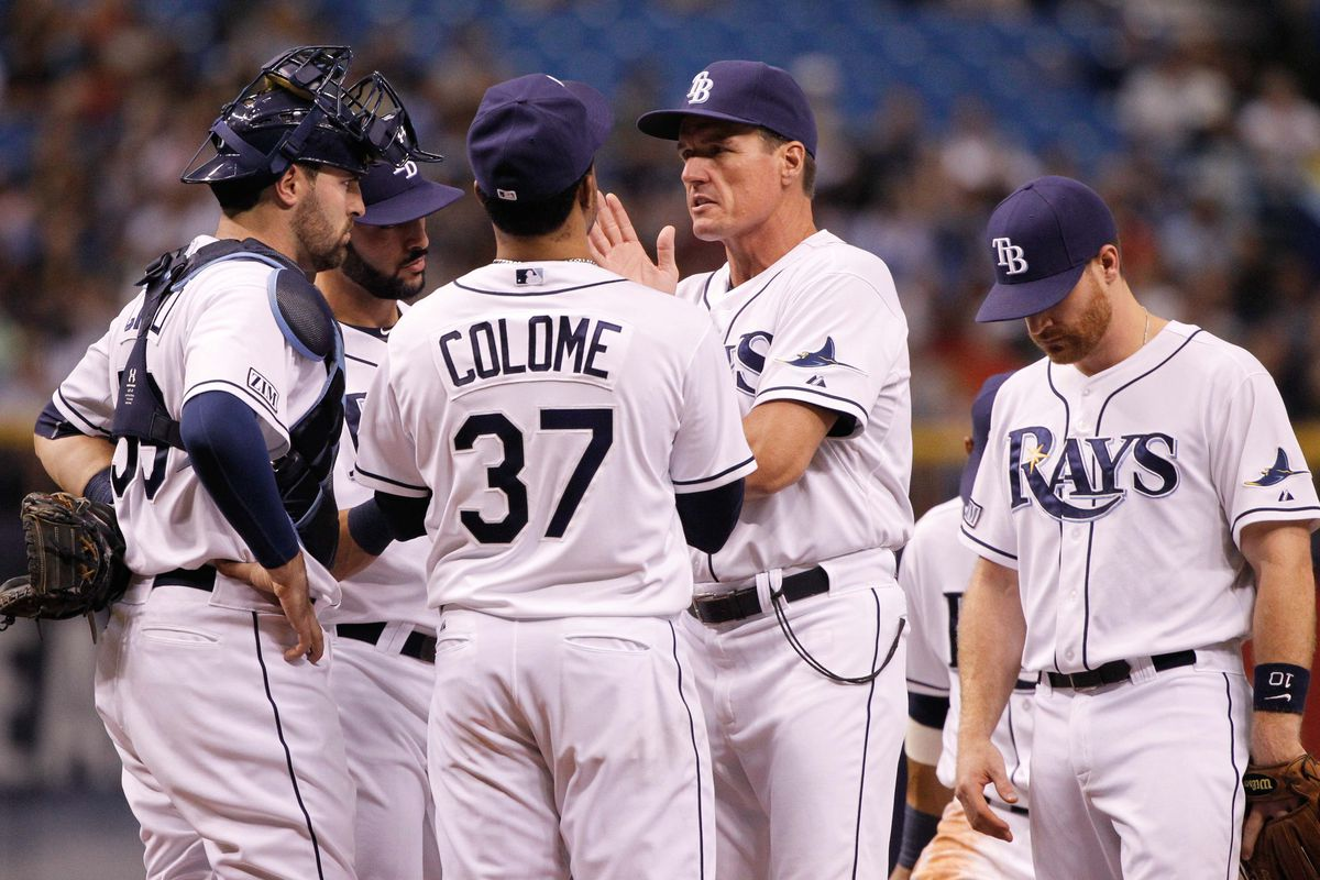 Who is the pitcher in the Alex Colome jersey?