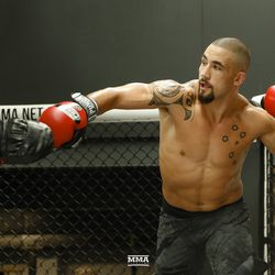 Robert Whittaker throws a punch during UFC 234 media workout.