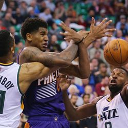 Utah Jazz forward Joel Bolomboy (21) fouls Phoenix Suns forward Marquese Chriss (0) as the Jazz and Suns play in Salt Lake City at Vivint Smart home arena on Wednesday, Oct. 12, 2016.