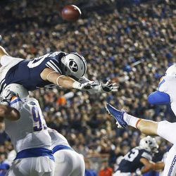 Brigham Young Cougars defensive lineman Corbin Kaufusi (90) tries to block a punt by Boise State Broncos kicker Joel Velazquez (46) in Provo on Friday, Oct. 6, 2017.