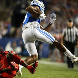 Utah Utes defensive back Boobie Hobbs (1) dives to try to stop Brigham Young Cougars wide receiver Jonah Trinnaman (3) on a run at LaVell Edwards Stadium in Provo on Saturday, Sept. 9, 2017.