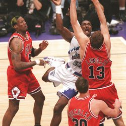 Karl Malone puts up a shot between Luc Longley (13) and Dennis Rodman during Game 6 of the NBA Finals.