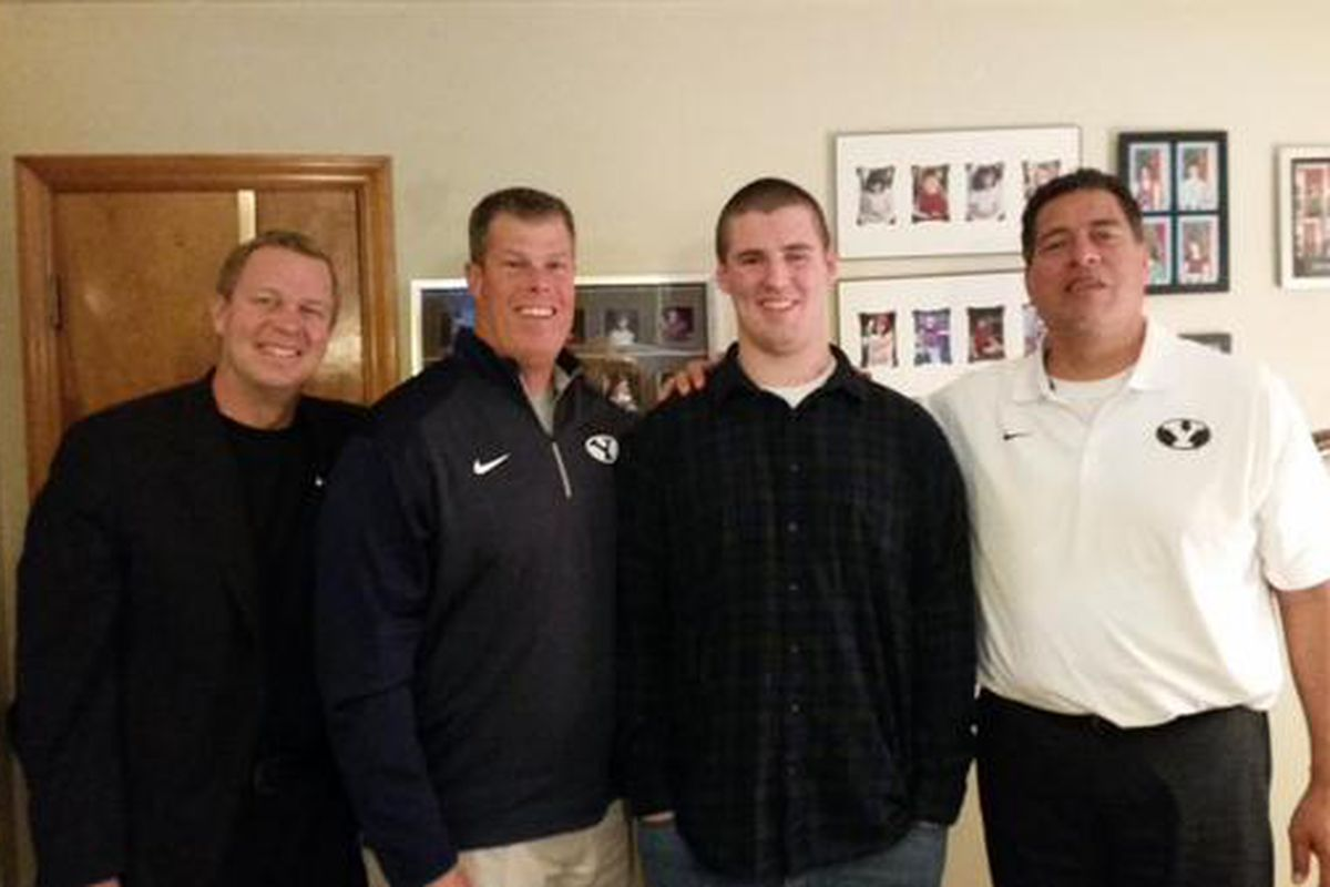 Hoyt with BYU coaches Mendenhall, Tujague, Anae from an in-home visit in January.