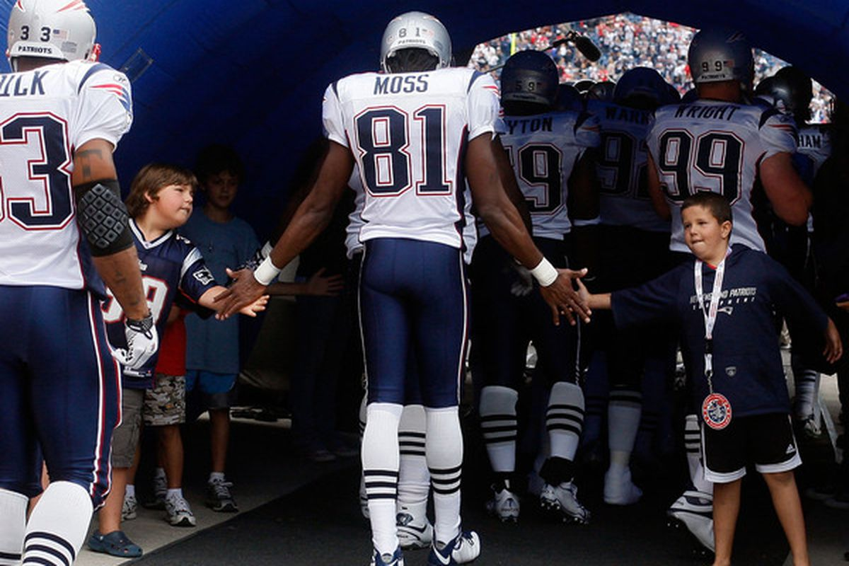 FOXBORO MA - SEPTEMBER 12: Randy Moss #81 of the New England Patriots enters the field before the NFL season opener against the Cincinnati Bengals at Gillette Stadium on September 12 2010 in Foxboro Massachusetts. (Photo by Jim Rogash/Getty Images)