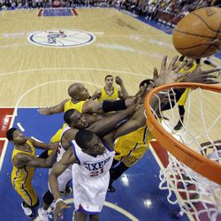 Philadelphia 76ers' Thaddeus Young, bottom center, and Elton Brand struggle for a rebound with Indiana Pacers' Paul George, from left, David West, George Hill and Roy Hibbert in the first half of an NBA basketball game, Tuesday, April 17, 2012, in Philadelphia.