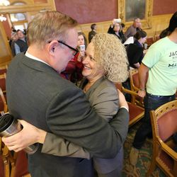 Salt Lake City Mayor-elect Jackie Biskupski hugs state Sen. Jim Dabakis after the Salt Lake City Council, acting as the city's  board of canvassers, certified final election results on Tuesday, Nov. 17, 2015 at the City-County Building in Salt Lake City. Biskupski beat Mayor Ralph Becker by 1,194 votes — 51.55 percent to 48.45 percent — with more than 38,000 votes cast.