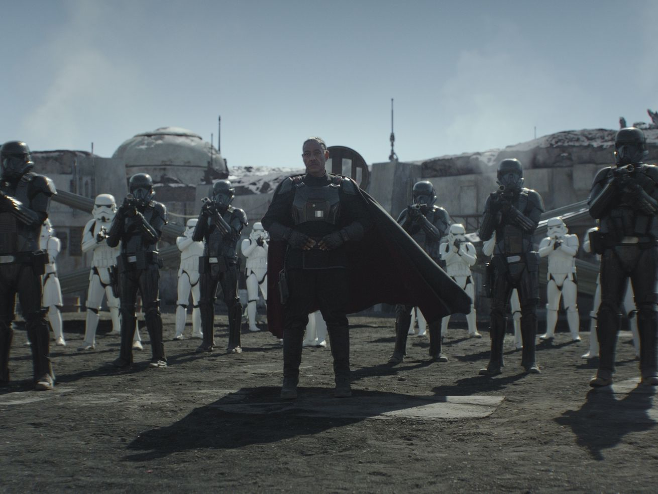 "Mof Gideon (Giancarlo Esposito) with stormtroopers and death troopers in ""The Mandalorian."""