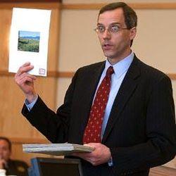 Prosecutor Scott Wyatt shows jury a photo of site where girl's remains were found.