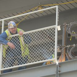 11:39 a.m. Fence being welded into place -