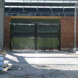 3:44 p.m. Concrete laid down, outside of Gate Q, on Sheffield -