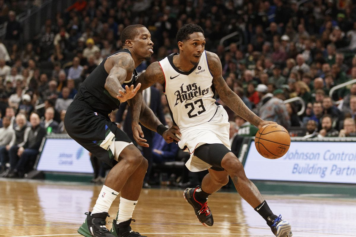 Los Angeles Clippers guard Lou Williams drives for the basket against Milwaukee Bucks guard Eric Bledsoe during the third quarter at Fiserv Forum.