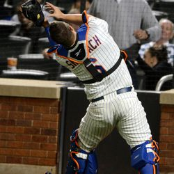 New York Mets catcher Kelly Shoppach misplays a foul ball hit by the Washington Nationals' Kurt Suzuki in the third inning of the baseball game in New York, Monday, Sept. 10, 2012. Suzuki hit a home run on the next pitch.