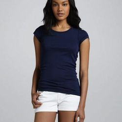 """Seven for all Mankind roll-up jean shorts, now $48 at <a href=""""http://www.neimanmarcus.com/p/7-For-All-Mankind-Roll-Up-Jean-Shorts-White/prod158130134/?ecid=NMALRFeedJ84DHJLQkR4&ci_src=14110925&ci_sku=prod158130134skuCLEANWHITE"""">Neiman Marcus</a>"""