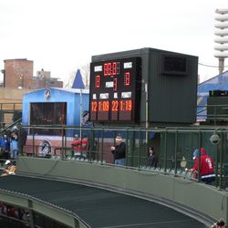 The auxiliary scoreboard, placed where the TV cameras normally are for baseball games