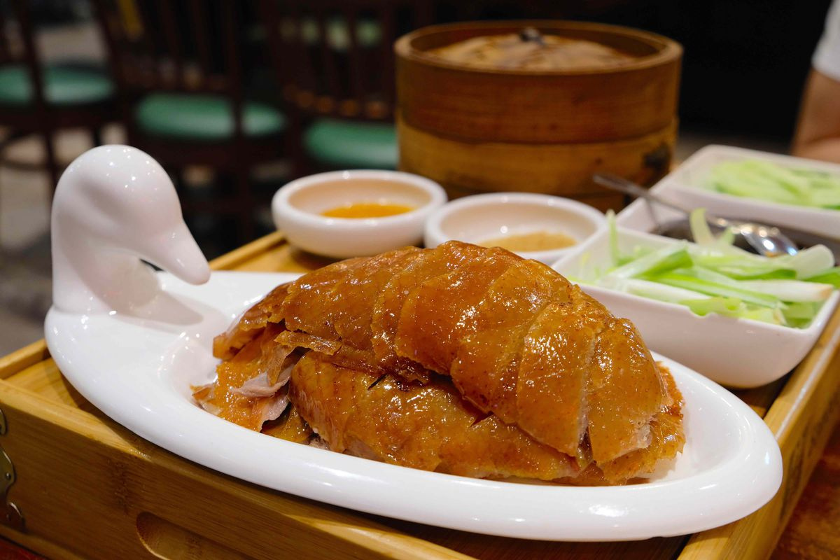 carved peking duck on a duck-shaped plate