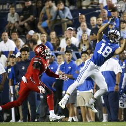 BYU wide receiver Gunner Romney (18) tosses pass from quarterback Zack Wilson (1), not in the shot, as he is protected by Utah's Jason Johnson (1) from Utah during the first half of the Utah football game -BYU at LaVell Edwards Stadium in Provo on Thursday, August 29, 2019.