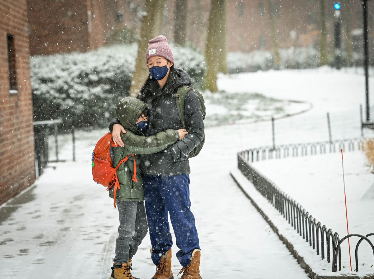 Nancy King walking in the snow with her son Drew.