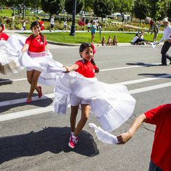 Ashleigh Flores, 10, right, performs a Peruvian dance with her group during the Days of '47 Union Pacific Railroad Youth Parade held Saturday, July 18, 2015, in Salt Lake City.