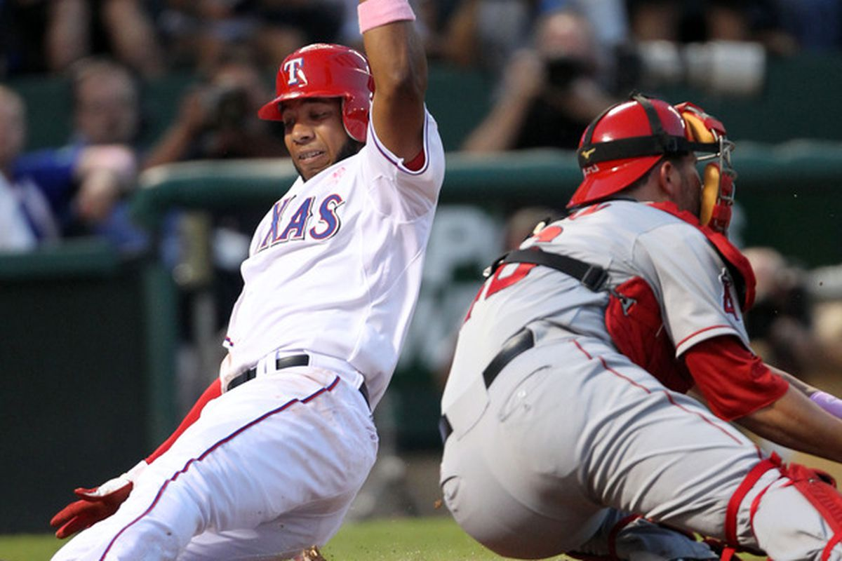 ARLINGTON, TX - MAY 13: Elvis Andrus #1 of the Texas Rangers beats the tag of the Los Angeles Angels of Anaheim catcher Bobby Wilson on May 13, 2012 in Arlington, Texas. (Photo by Layne Murdoch/Getty Images)