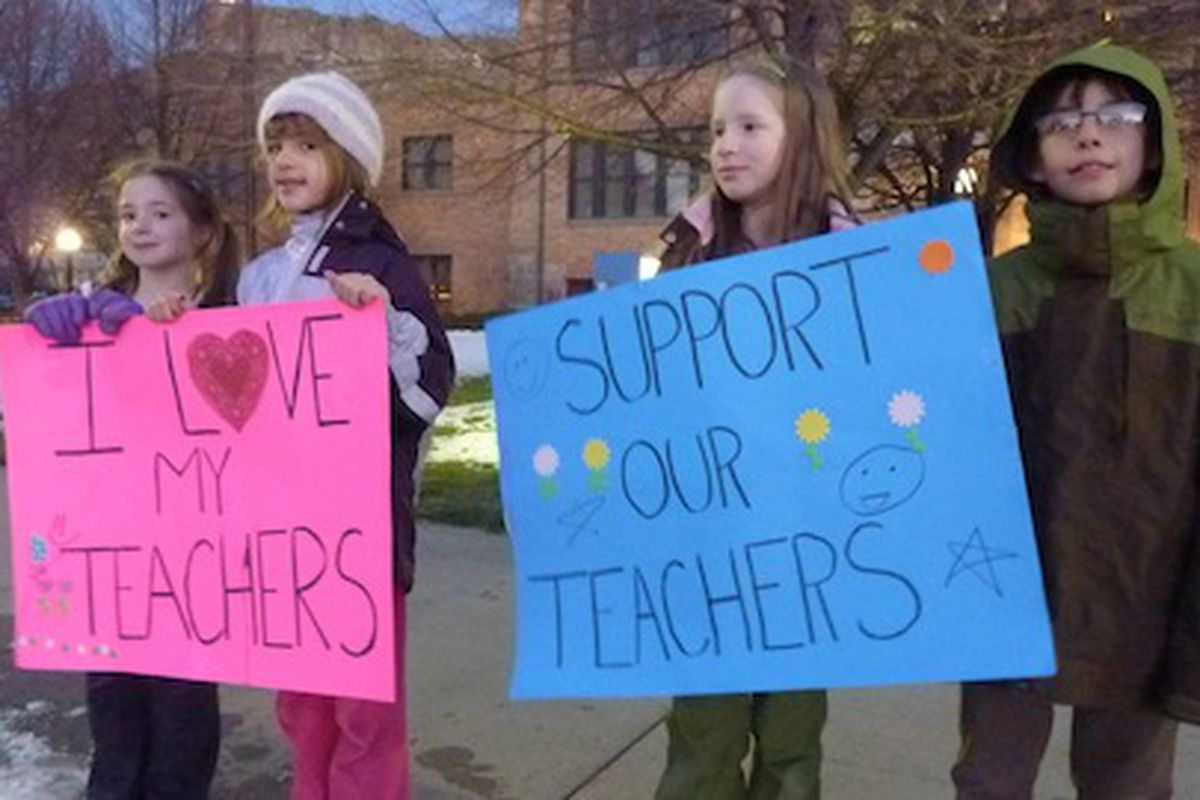 """Two of Dougco parent Meredith Massar's daughters join friends in a """"peaceful protest"""" outside the Douglas County Public Schools administration building Thursday."""